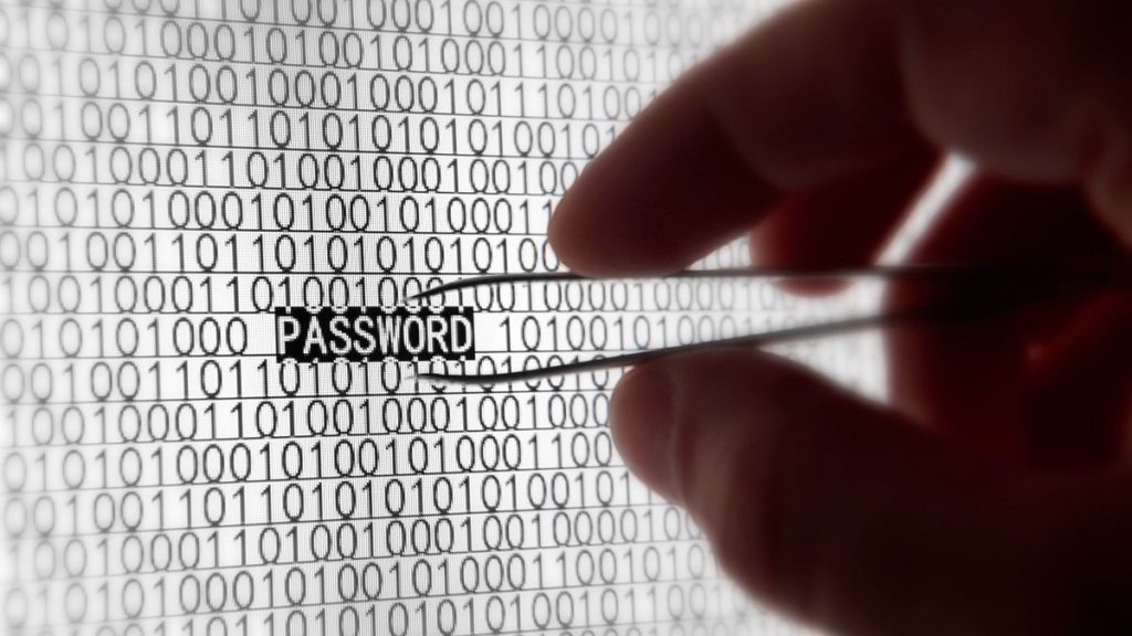 Somone plucking the word 'password' out of a screen with a pair of tweezers