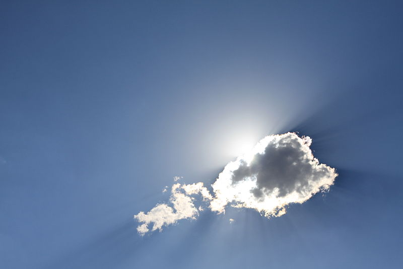 A cloud in the sky with sunlight filtering through it