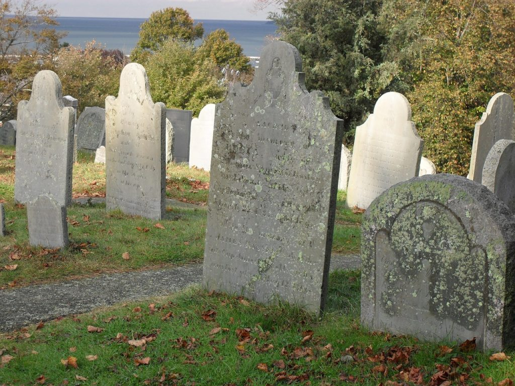 A row of gravestones in a graveyard