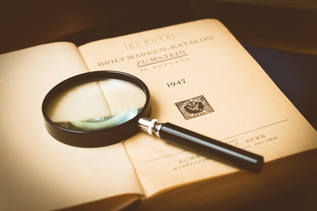 A magnifying glass laying on an open book